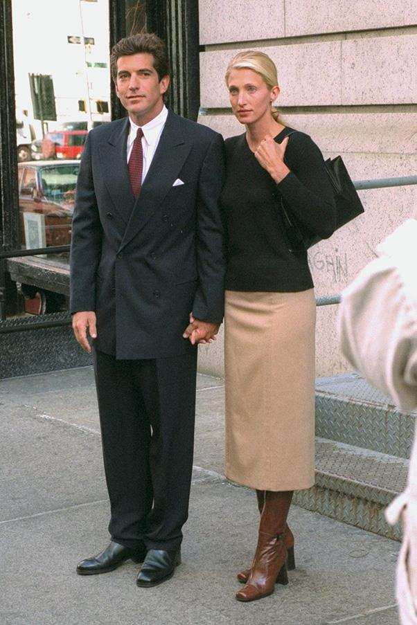 With husband John F. Kennedy outside their Tribeca apartment, 1998
