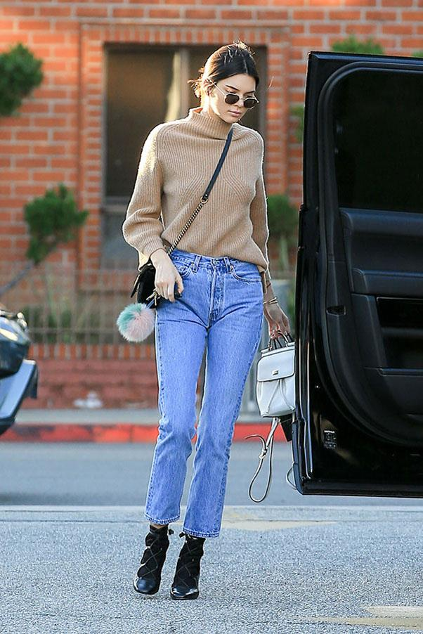 Kendall stepped out in Los Angeles in a nude turtleneck sweater, paired with classic blue jeans and black lace up boots with socks, accessorised with a black Gucci bag.