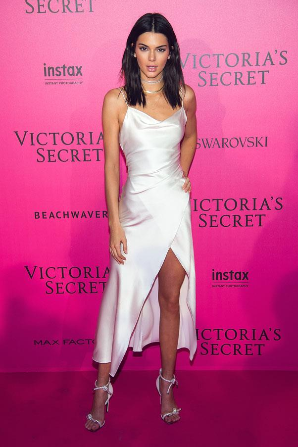 Kendall wore a Camilla and Marc slip dress to the Victoria's Secret Fashion Show After Party, paired with white rope-tied heels and ERTH jewelry by Nicole Trunfio.