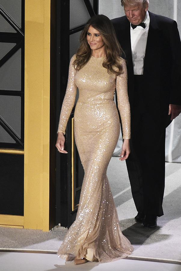 Melania opted for a gold floor-skimming gown to a pre-Inauguration event in Washington.