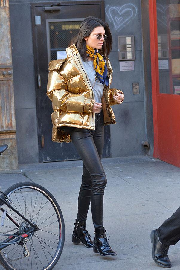 Jenner wearing a metallic-gold bomber jacket in New York.