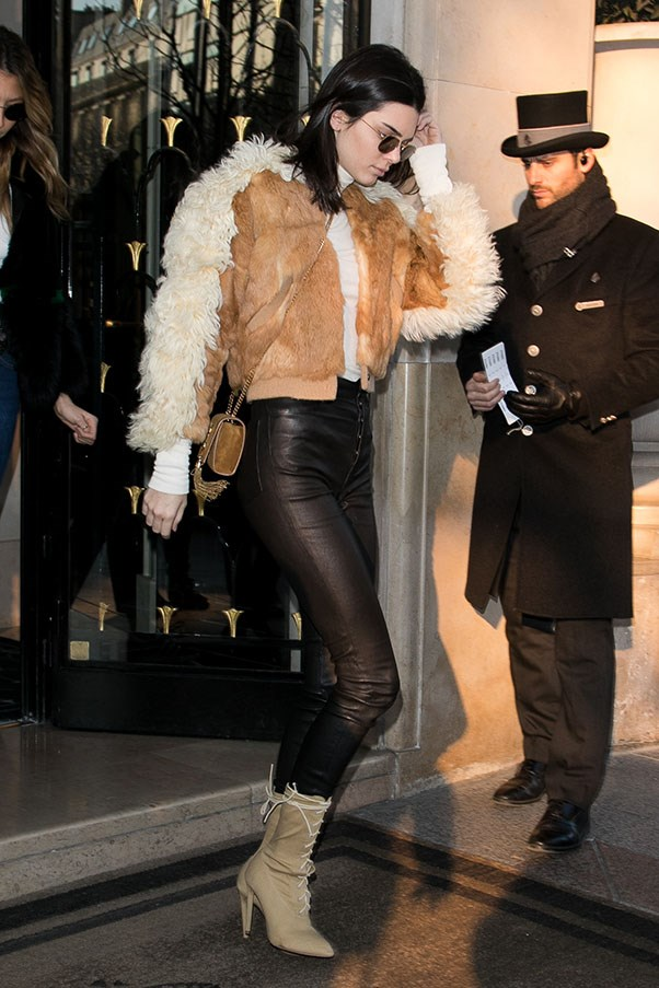 Jenner rocks yet another staple bomber jacket and black leather pants.