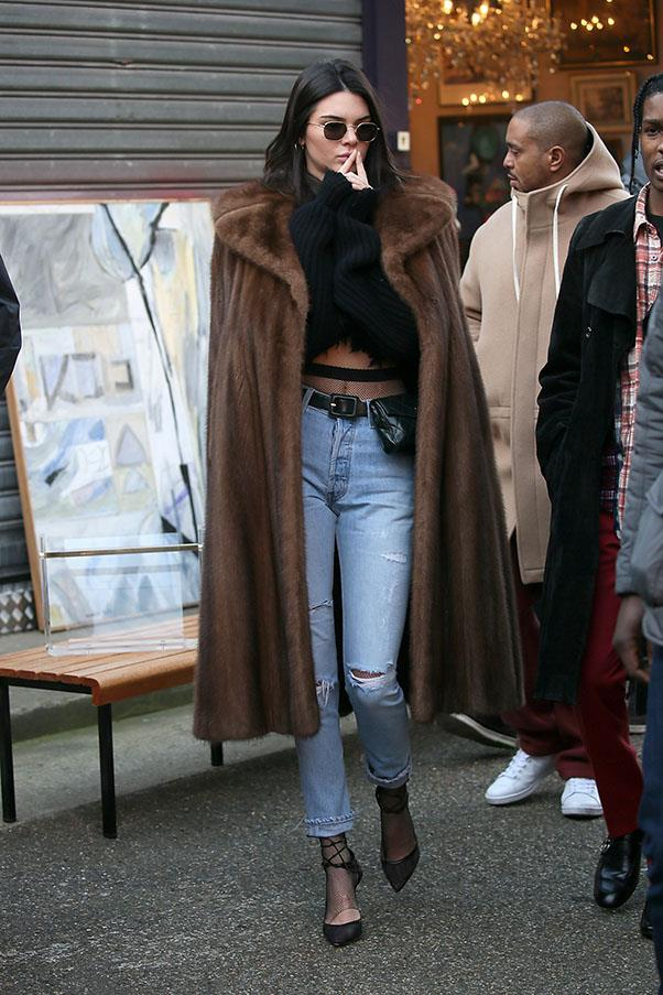 Jenner spotted out shopping in a Paris flea market with A$AP Rocky in a floor length fur coat and blue jeans.