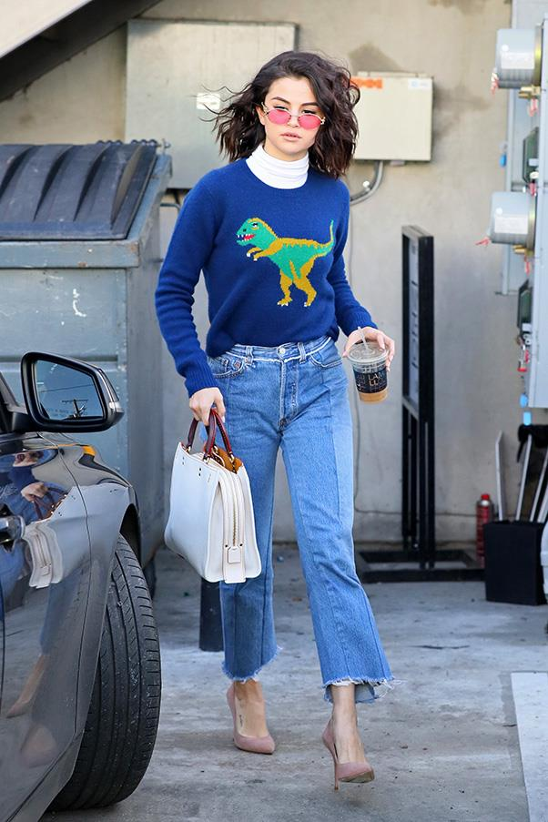 <strong>January, 2017</strong><br><br> Selena stepped out in a sophisticated-yet-playful dinosaur jumper by Coach and cropped flare jeans in Los Angeles.