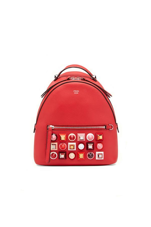 "Fendi backpack, approx. $2,170 at <a href=""https://www.ssense.com/en-us/women/product/fendi/red-mini-studded-backpack/1764413?forced_user_country=AU&gclid=COvrjqXV4dECFYZjvAodowYPzw"">Ssense</a>"