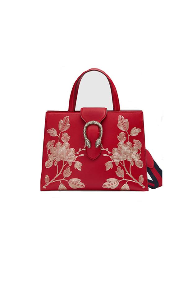 """Gucci bag, $3,265 at <a href=""""https://www.gucci.com/au/en_au/pr/women/handbags/womens-totes/chinese-new-year-dionysus-top-handle-bag-p-444073CWDAN9864?position=2&listName=ProductGridComponent&categoryPath=Gifts/Chinese-New-Year"""">Gucci</a>"""