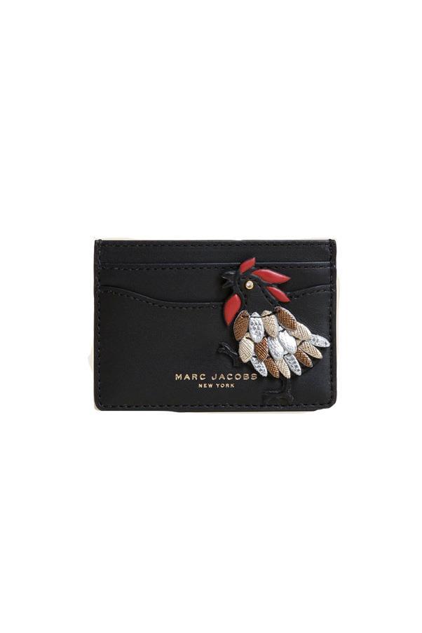 "Marc Jacobs card holder, approx. $206 at <a href=""https://www.shopbop.com/fire-rooster-card-case-marc/vp/v=1/1523874507.htm?fm=search-viewall&os=false&extid=affprg_CJ_SB_US-3648553-Skimlinks&cvosrc=affiliate.cj.3648553"">Shopbop</a>"