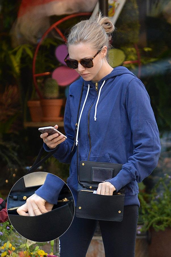 Amanda Seyfried also opted for a minimal gold band over a diamond engagement ring.<br><br> Images: Splash News