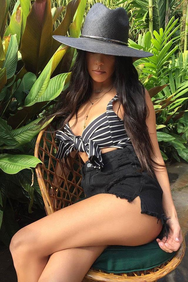 "<strong>By Johnny</strong><br><br> Kourtney Kardashian was spotted in Costa Rica sporting one of By Johnny's retro-inspired bralette.<br><br> Shop the holiday MVP in all-black (striped version to come) <a href=""http://www.byjohnny.com.au/shop/products/graphite-tie-front-bralette/black"">here</a>."