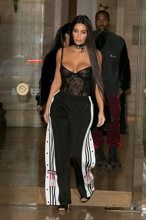 <strong>September 29th, 2016</strong><br><br> Kim paired a sheer lacey corset with adidas track pants to go to dinner at Ferdi with husband Kanye West in Paris.
