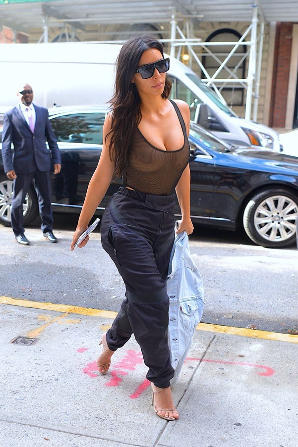 <strong>September 9th, 2016</strong><br><br> Kim paired a (very) sheer bodysuit with high-waisted trousers and strappy nude sandals out in New York City.