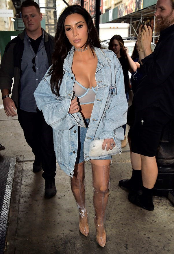 <strong>September 6th, 2016</strong><br><br> Wore double denim, a sheer bralette and thigh-high perspex boots by Yeezy while out and about in New York city.