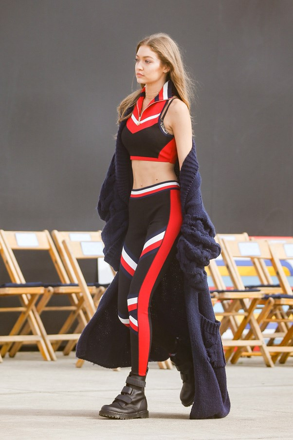 Wearing her Tommy x Gigi collection before walking for the collection's second fashion show.
