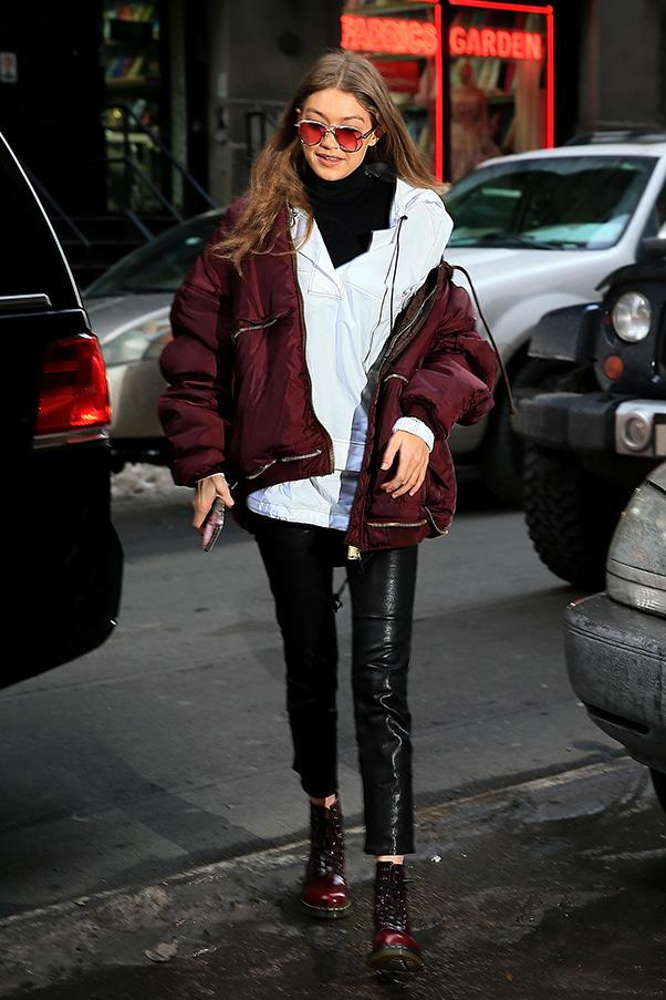 "<strong>Bassike</strong><br><br> Gigi Hadid rocked a white hooded anorak by Australian favourite bassike while out and about at New York fashion week. <br><br> Shop the anorak <a href=""http://www.bassike.com/women/jackets-coats/cotton-athletic-hooded-anorak-aw17wfj96-wht"">here</a>, for $495."