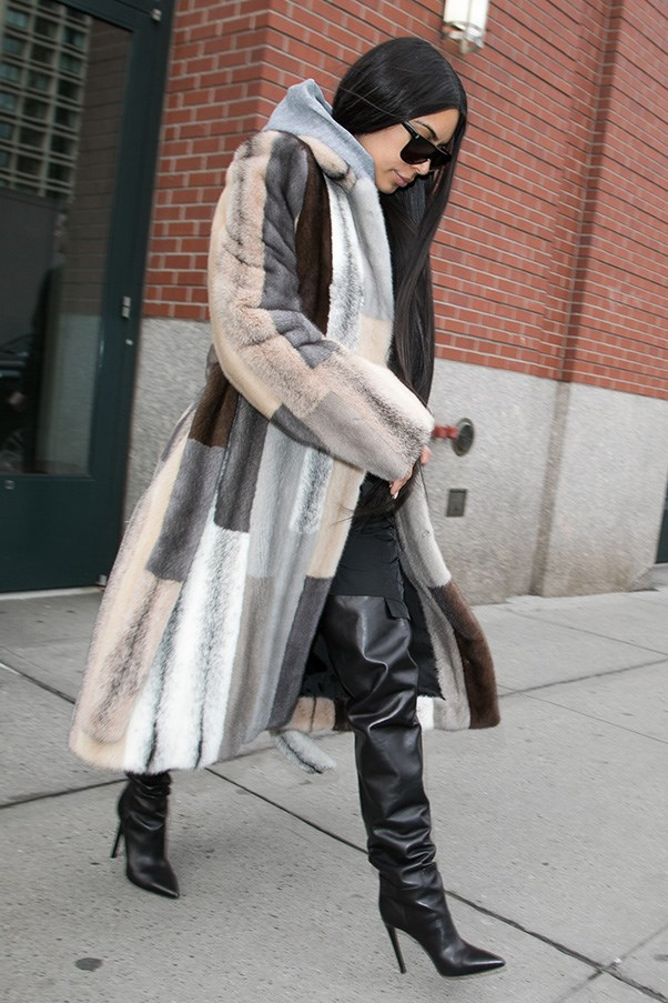 <strong>February 14th, 2017</strong><br><br> Kim wore a floor-length fur coat and thigh high black boots while out in New York during fashion week.