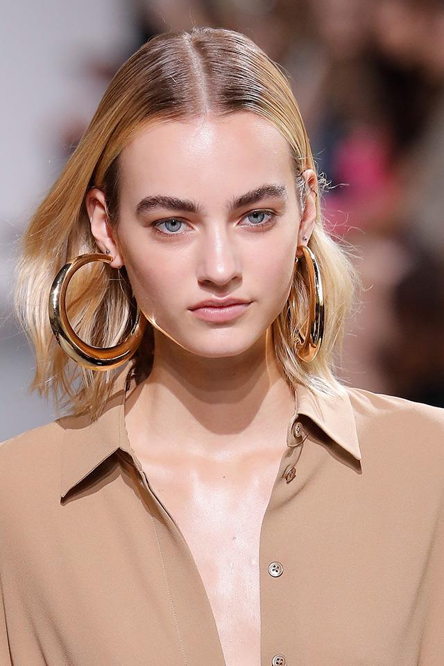 """<em>As soon as you put volume in the hair, it makes you look older. The more effortless the style, the more modern, young and fresh it looks</em>,"" says Stoddart. <br> <br> ""<em>Everyone backstage is taking volume out of the hair at the moment</em>."""