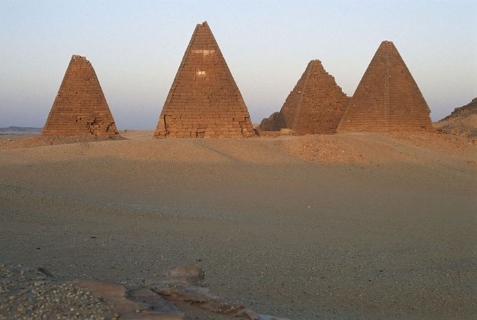 """<strong>13. Gebel Barkal and the Sites of the Napatan Region: Meroe, Sudan</strong> <br><br> <a href=""""http://whc.unesco.org/en/list/1073"""">The Gebel Barkal</a> is a 324-foot flat-topped mountain that has been sacred since it was deemed holy by Egyptians in 1500 B.C., and its still holy to Muslims who continue to visit it today. Here you'll also find sacred tombs, pyramids, temples and palaces that date as far back as 900 B.C., and span over a 37-mile stretch on the bank of the Nile."""