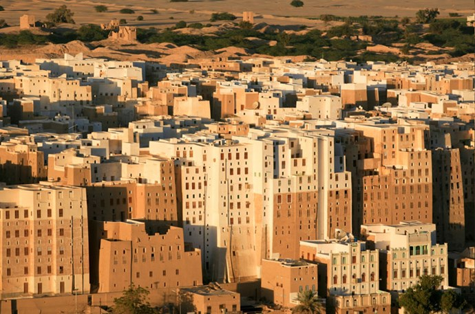 """<strong>15. Shibam: Central Yemen</strong> <br><br> <a href=""""http://whc.unesco.org/en/list/192"""">Shibam </a>was built in the 16th century and is surrounded by a massive protective wall. It's known as """"the Manhattan of the desert"""" because of its tall high-rise mud brick buildings and grid layout."""
