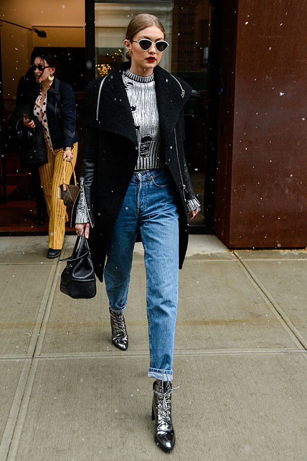 Gigi takes her shoe game to a whole new level with her shiny metallic boots.