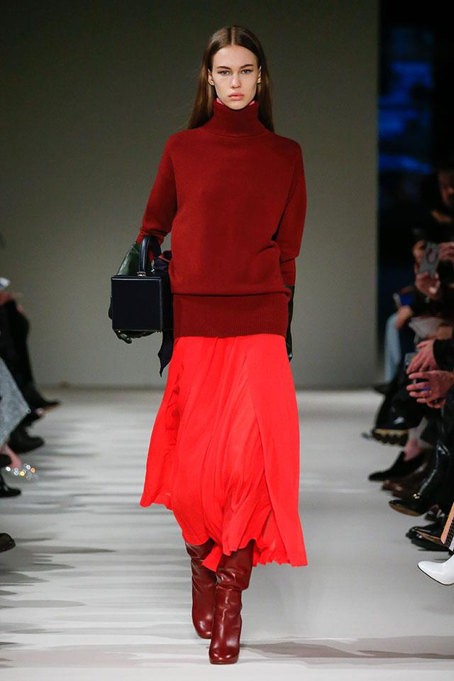 """<strong>8. Victoria Beckham</strong> <br></br> """"The colour juxtaposition of this look is remarkable. The pinkness of the red skirt paired with a burgundy top is simply genius. Victoria Beckham's entire show was just a masterclass in modern dressing; so chic and understated with just the right amount of fashion factor. Everything from the blazers and wide legs pants to the midi length skirts and knee high boots felt perfectly effortless and fluid."""""""