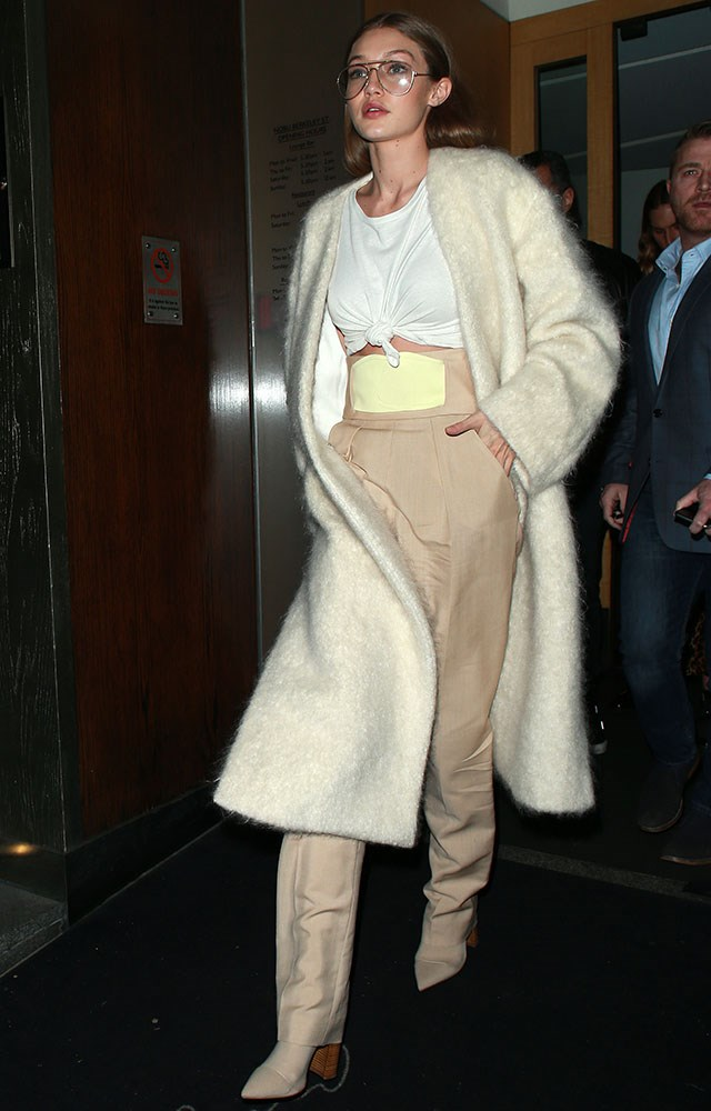 """<strong>Tony Bianco</strong><br><br> Gigi Hadid steps out at London fashion week wearing boots by one of your high-street favourites: Tony Bianco. Shop the boots <a href=""""http://www.tonybianco.com.au/diddy-sand-onyx.html#"""">here</a> for $219.905."""