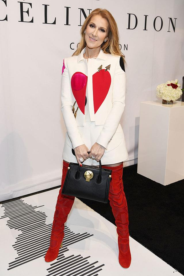 <strong>February 21st, 2017</strong><br><Br> Celine sported a killer Elsa Schiaparelli couture set, teamed with scarlet suede thigh-high boots, to the launch of her new bag in Las Vegas. <BR><BR>