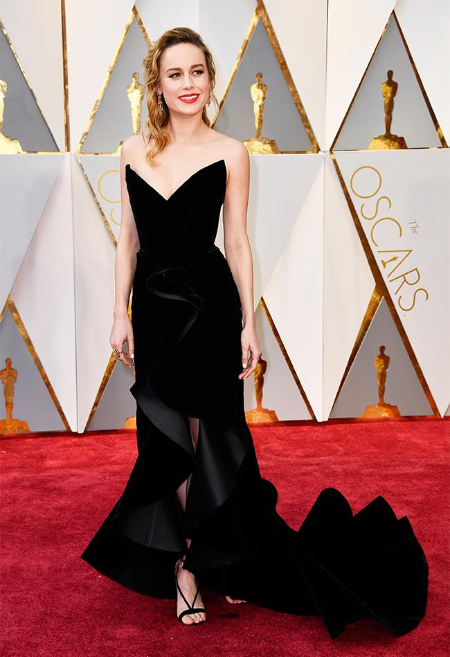 "<strong>Brie Larson: </strong> <br><br> ""I am crushing on anything and everything velvet at the moment. I really like the neckline of this Oscar de la Renta dress and how it fits on her body. The ruffle and volume on this dress is heavenly."" — Caroline Tran, market editor <br><br> ""Who knew a strapless ruffled gown could look edgy?"" — Jessica Matthews, deputy chief sub editor"