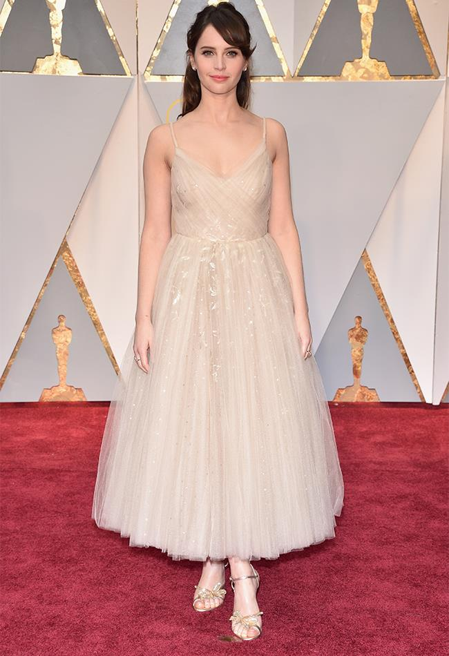 "<strong>Felicity Jones: </strong> <br><br> ""(I seriously feel mean writing negative things) BUT the dress is very beautiful, but I'm not sure about the fit on her body. "" — Caroline Tran, market editor <br><br> ""This pretty Dior prom dress washes Felicity out and isn't doing her figure any favours either"" — Alison Izzo, digital managing editor"