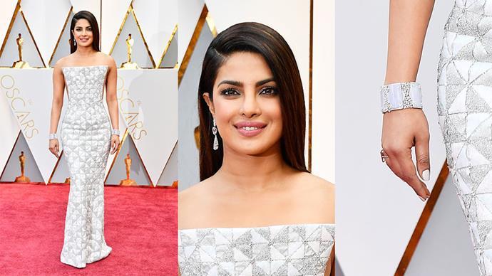 <strong>Priyanka Chopra</strong> <br><br> Diamond earrings, cuff and ring.