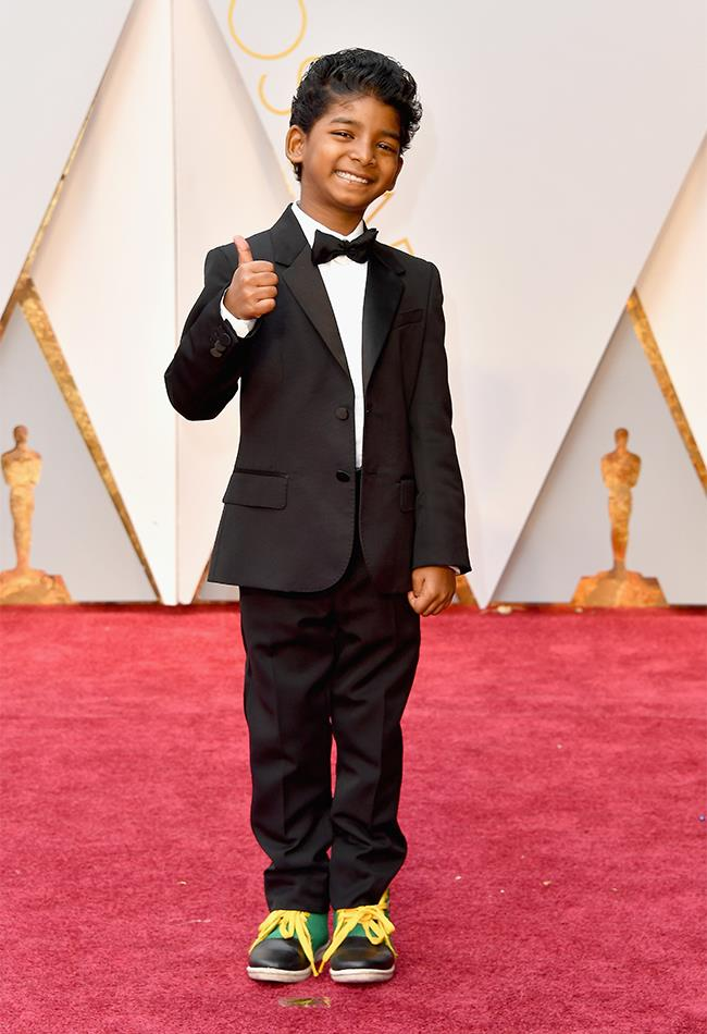 "<strong>Sunny Pawar: </strong> <br><br> ""I wish I could get a tux to fit this well. I wish I could make my eight-year-old this happy to attend any sort of adult function. And I bet his publicist didn't have to threaten to withdraw Minecraft privileges in order to get him to put his shoes on, either."" — Tom Lazarus, chief sub editor <br><br> ""I cannot resist the incredibly powerful tiny tuxedo/happy sneaker combo championed by this guy. And you know, it's a perfectly age appropriate choice, and he's feeling awesome in those increds kicks… not like he's dressed up like some creepy little undertaker on the loose."" — Eliza O'Hare, associate editor"