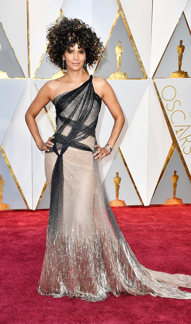 "<strong>Halle Berry: </strong> <br><br> ""The 2017 Oscars' would have to be one of the most conservative I've seen in years so thumbs up to Halle Berry for the fab BIG hair that says 'Hello, the red carpet shouldn't be taken so seriously!"" — Kellie Hush, editor-in-chief"