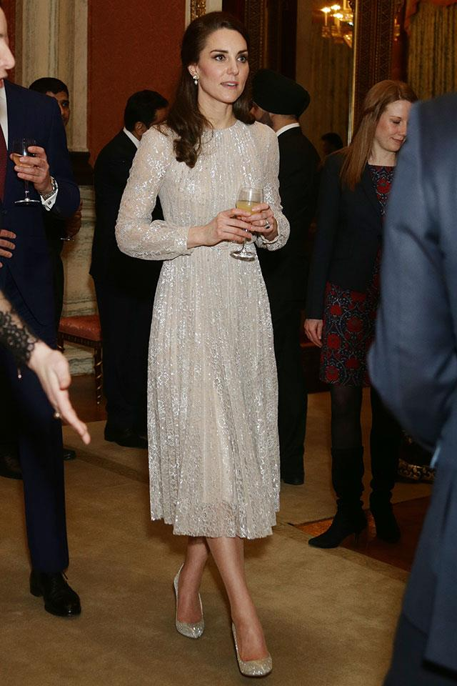 The Duchess stepped out at Buckingham Palace overnight wearing a shimmery Erdem midi dress finished with matching pumps and Anita Dongre earrings.