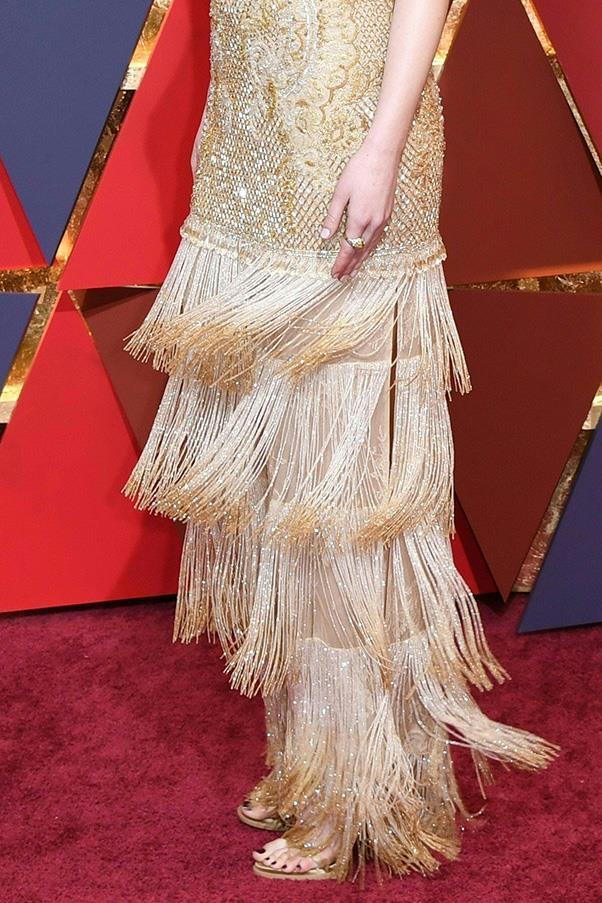 The beaded fringe and Emma's matching gold heels.