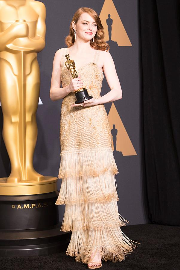 The colour of the gown perfectly complimented Stone's Best Actress award.