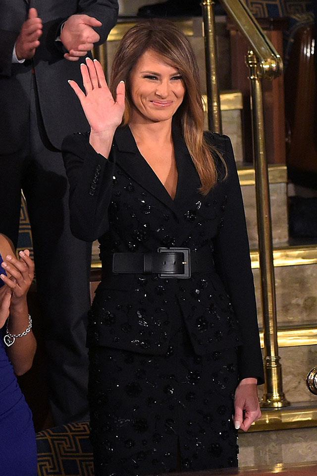 "Melanie wore a $13,000 embroidered ebony Michael Kors suit to Donald Trump's first speech to Congress, standing in stark contrast to Democratic congresswomen who sported all-white to ""stand in solidarity with the women of our nation"". When asked for comment on the First Lady's controv, Kors told <em>BAZAAR.com</em>, ""Mrs. Trump has been a longtime client at our New York boutique. She has a keen understanding of what works best for her and her lifestyle. My embroidered black suit reflects the streamlined glamour that she is known for."""