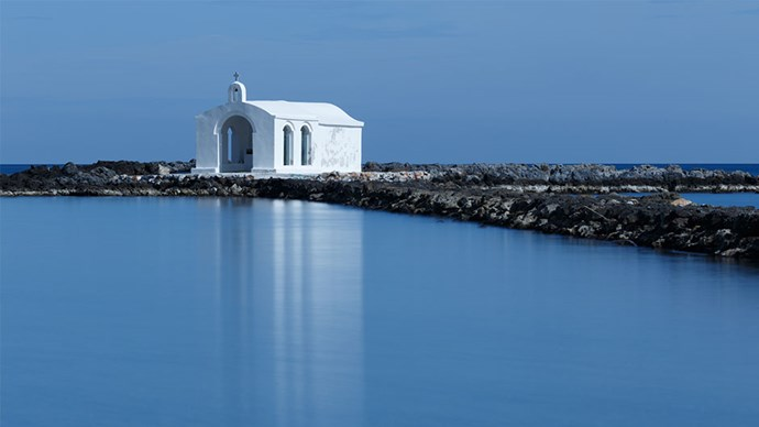 <strong>St. Nicholas Chapel, Georgioupolis, Crete</strong> <br><br> Located about 100 metres out into the Sea of Crete, this Mediterranean chapel was originally built as a guardian for sailors and fishermen.