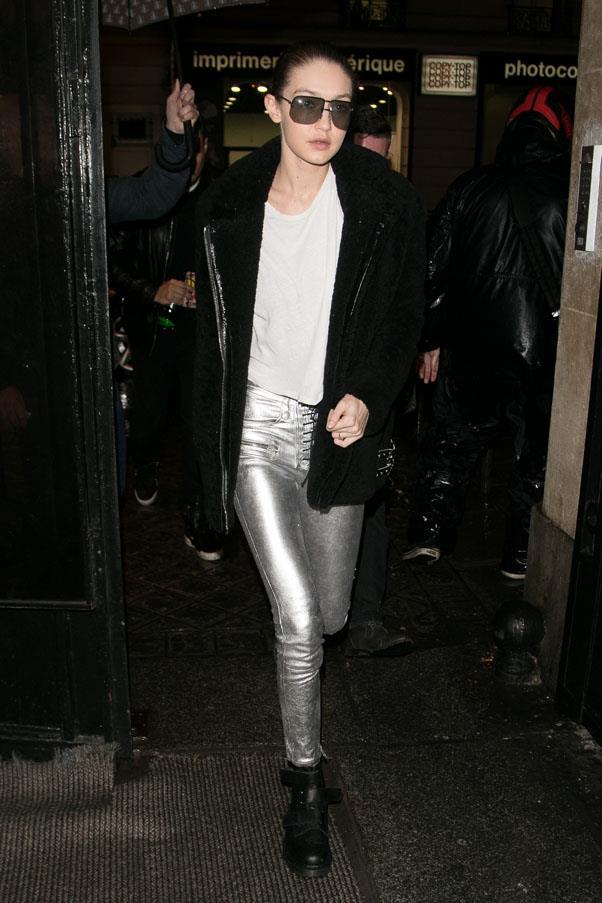 Hadid wearing metallic silver pants and oversized sunnies in Paris.