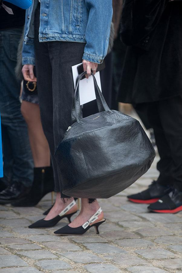 A Balenciaga bag and Dior shoes at Paris fashion week.