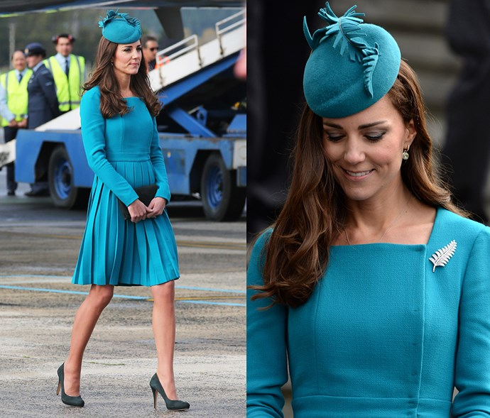 <em>Teal</em> <p> In dark green, the shoes might not be a perfect match for the rest of her teal outfit, but she gets a pass because she was on tour. (And because they <em>do</em> match her clutch.)