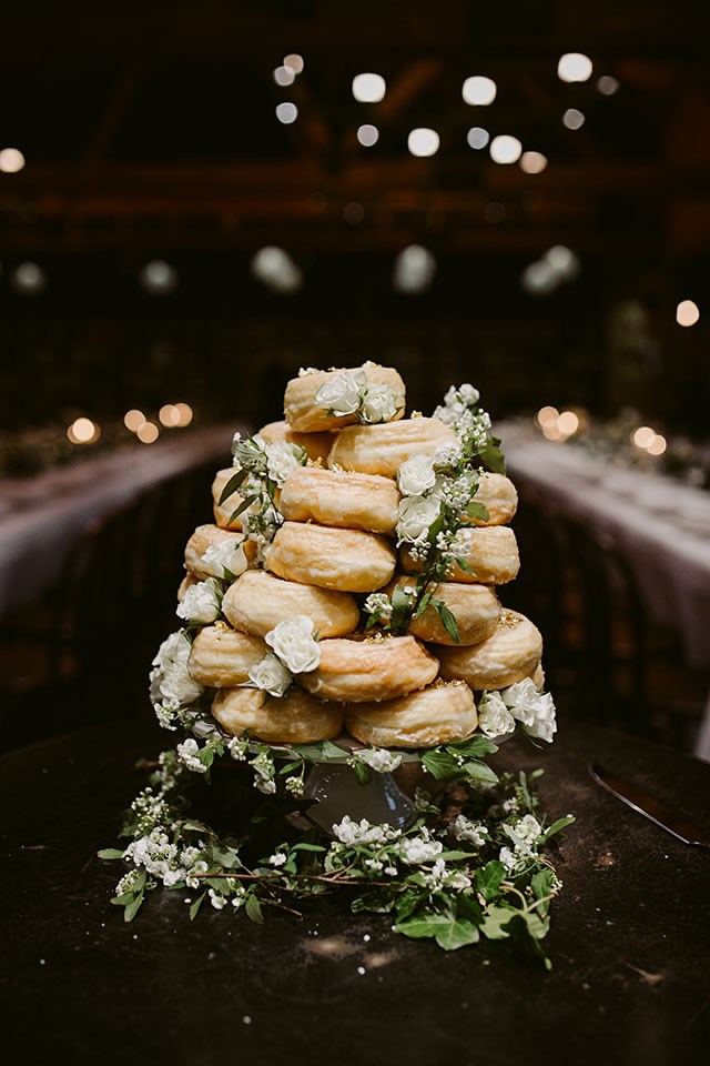 <strong>On the cake: </strong> <br></br> It wasn't difficult to pick out our cake at all. I'm obsessed with doughnuts, so I approached Doughnut Time about making a custom wedding cake. They loved the idea and it was a hit with all the guests.