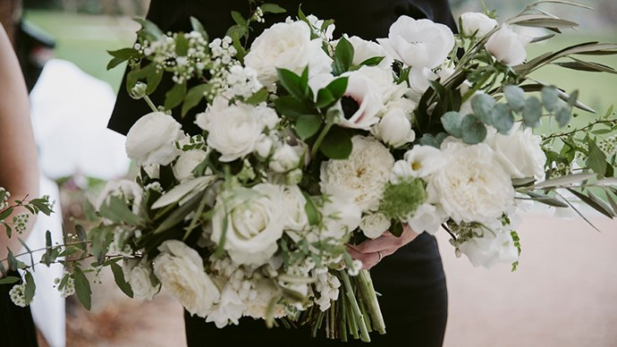 <strong>On the flowers: </strong> <br></br> For the bouquets, I had a mix of flowers including anemones, David Austin roses, ranunculas and garden roses, all white in colour with some greenery mixed in. The tables featured trailing garlands in whites, ivory and green. The overall look was fresh and classic. I wanted to be able to look back in 20 years and still think they looked amazing.