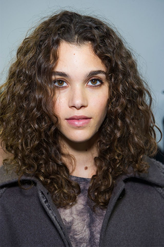 "2. Apply a leave in moisturizer to damp hair and then use a strong hold curl defining product over the top for hold without frizz. <a href=""http://www.redken.com/products/hair-care/curvaceous/curly-hair-anti-frizz-lotion-ringlet"">Redken Curvaceous Ringlet Anti-Frizz Perfecting Lotion</a> ($32.95) is great!"
