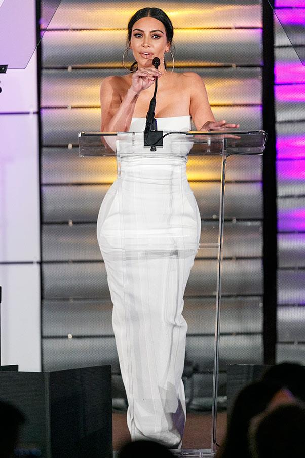 Kim wore a figure-hugging white dress and a lip ring to the Family Equality Council's Impact Awards in Los Angeles.