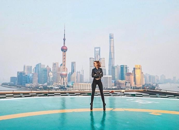 "Josephine Skriver stood against the Shanghai skyline. <br><br> Image: <a href=""https://www.instagram.com/p/BRXZuuBDqCs/"">@josephineskriver</a>"