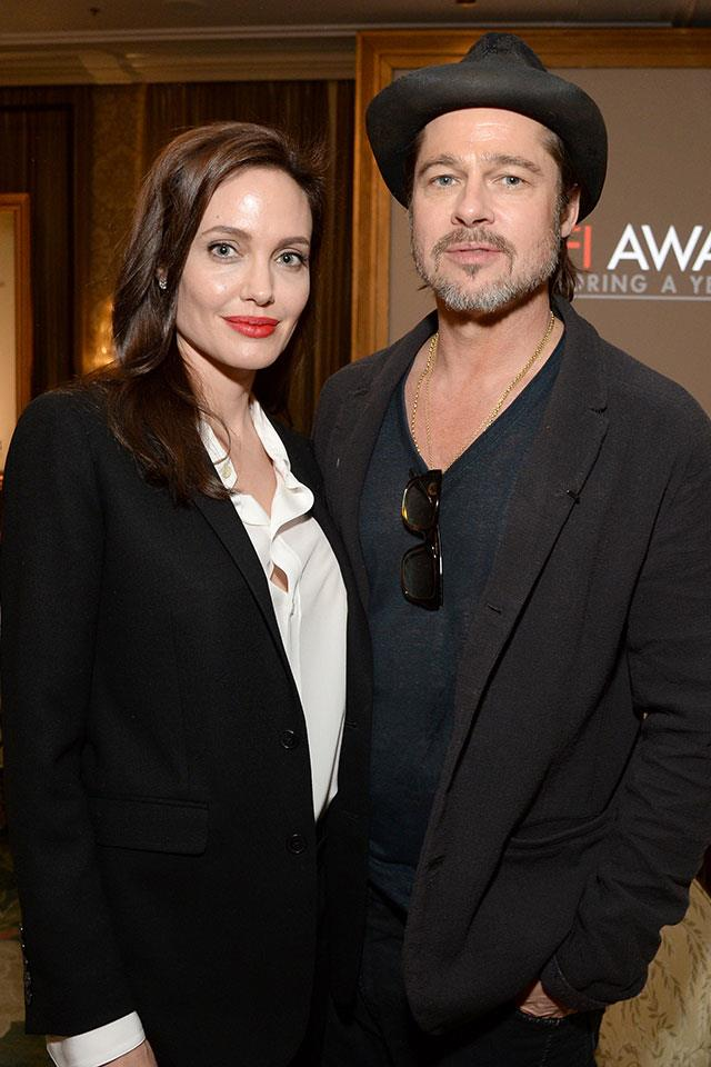 """<strong>Brad Pitt and Angelina Jolie got matching tattoos shortly before separating</strong> <br><br> In March 2017, it was revealed that Brad Pitt and Angelina Jolie <a href=""""http://www.etonline.com/news/212773_angelina_jolie_got_matching_tattoo_with_ex_brad_pitt_months_before_split_pic/"""" target=""""_blank"""">got tattoos to commemorate their relationship</a> just months before announcing their divorce. In February 2016, Jolie and Pitt were both tattooed by Ajarn noo Kanpai, a former monk in Thailand. The monk inked Jolie with three intricate """"magical"""" Sak Yant tattoos on her back, and added a Buddhist symbol to the left side of Pitt's stomach. The same ink was used for both Jolie and Pitt's tattoos as a way """"to symbolically bind them as husband and wife."""" They announced their split seven months later."""