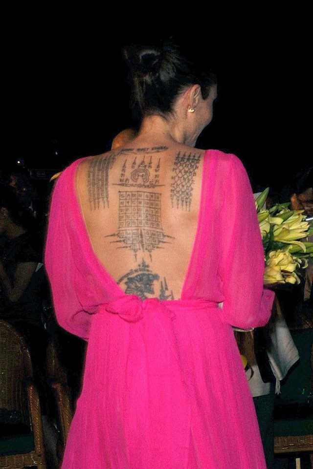 Jolie's tattoos could be seen when she wore this backless dress in Cambodia in February 2017, where she promoted her new film <em>First They Killed My Father</em>.