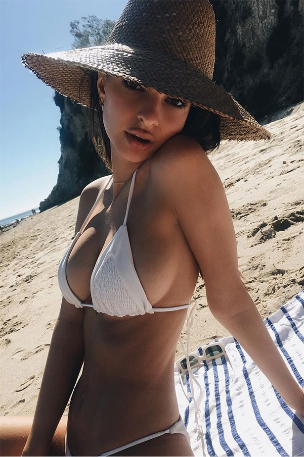 """<strong>Lack Of Color</strong><br><br> Emily Ratajkowski shared a holiday snap beachside sporting one of  Queensland label, Lack Of Color's, signature straw hats. Shop the Sundowner style <a href=""""https://www.lackofcolor.com.au/collections/straw/products/the-sundowner"""">here</a> for $115."""