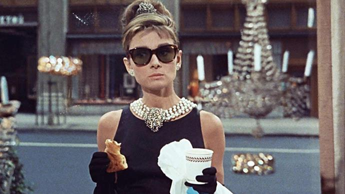 <p>Hubert de Givenchy for <em>Breakfast at Tiffany's (1961)</em><p> Easily considered to be one of (if not, the) most iconic dresses in film history, the little black dress with opera gloves in <em>Breakfast at Tiffany's</em> was designed by Audrey Hepburn's close friend, Hubert de Givenchy.