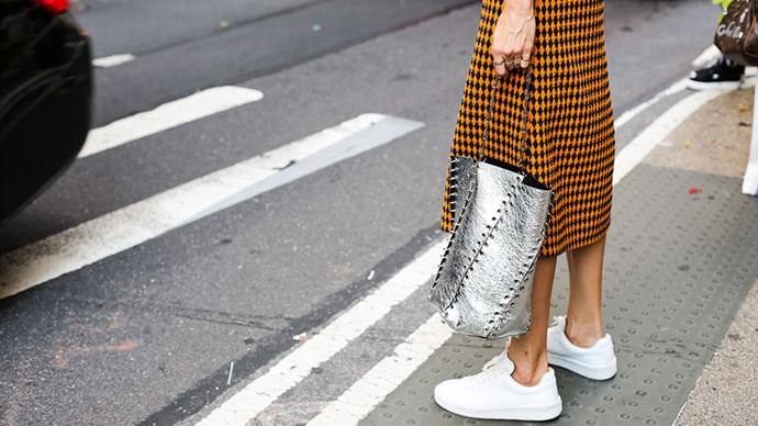 """<strong>1. White sneakers</strong><br><br> The fashion world is still amidst a white sneaker obsession, and while you <em>can</em> fork out upwards of $600 on a pair, the cult-ish Adidas Stan Smiths or Superstars are your best bet, at around $150. <br><br> Buy: Stan Smith sneakers by Adidas, $150 at <a href=""""http://www.theiconic.com.au/stan-smith-341862.html"""">The Iconic</a>. <br><br>Image: India Hartford Davis, <a href=""""https://www.instagram.com/backstreetbyindia/?hl=en"""">@backstreetbyindia</a>"""