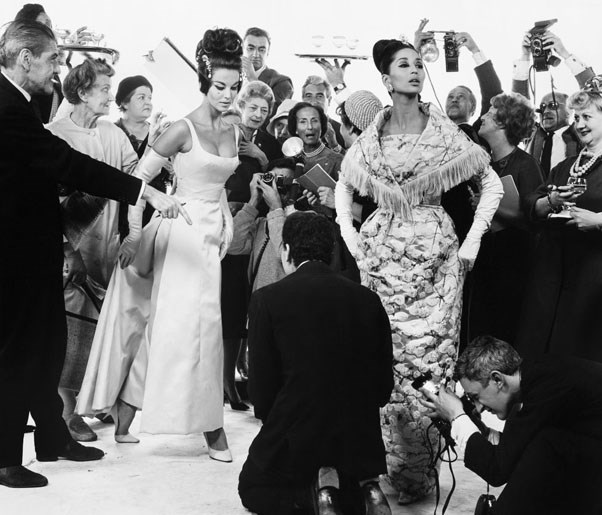 Margot McKendry and China Machado with members of the French Press, dresses by Lanvin-Castillo and Heim, Paris studio, August 24, 1961